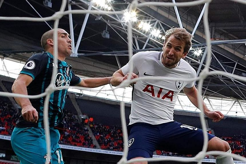 Harry Kane scoring Tottenham's second goal against Southampton in their league match at Wembley. His third strike completed his second-hat-trick in four days and his sixth of the calendar year.