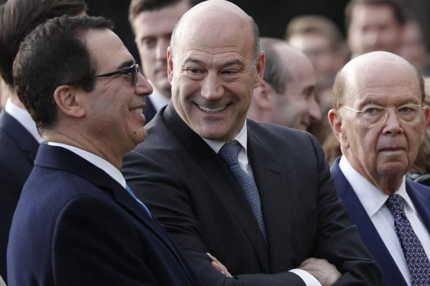 US Treasury Secretary Steven Mnuchin stands with Chairman on the National Economic Advisory Gary Cohn and Commerce Secretary Wilbur Ross on the South Lawn of the White House in Washington, US on Dec 20, 2017.