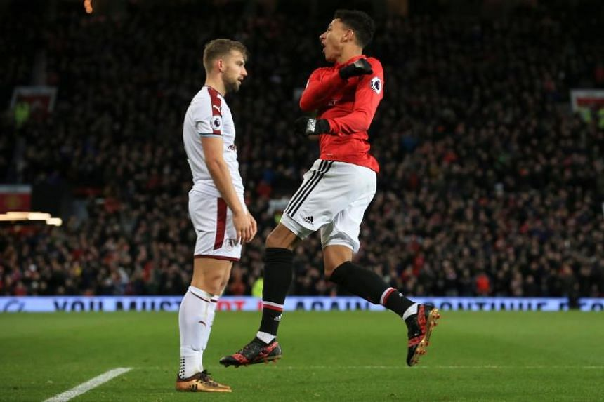 Manchester United's English midfielder Jesse Lingard (right) celebrates scoring their first goal during the match between Manchester United and Burnley at Old Trafford in Manchester, north west England, on Dec 26, 2017.