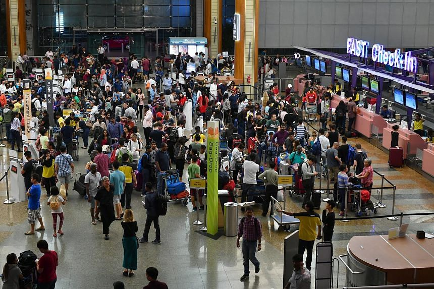 Passengers at Changi Airport Terminal 2 Departure Hall on Dec 18, 2017.
