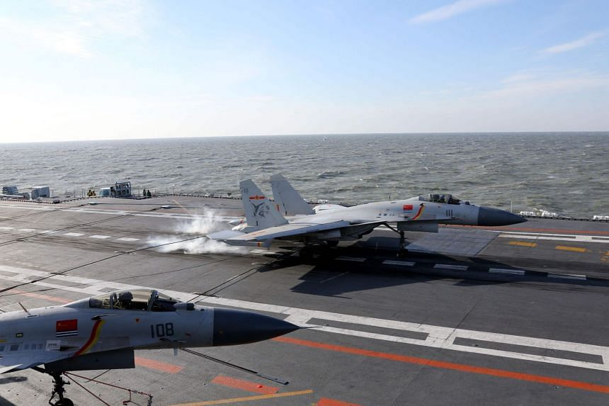 File photo of a Chinese J-15 fighter jet landing on the deck of the Liaoning aircraft carrier during military drills in the Bohai Sea, off China's northeast coast.