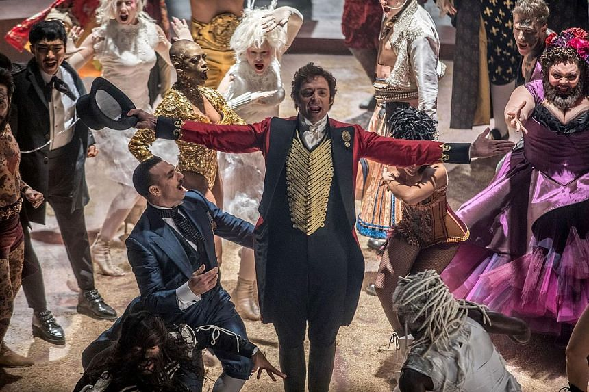 Hugh Jackman (centre) plays huckster and circus founder P.T. Barnum in the musical The Greatest Showman.