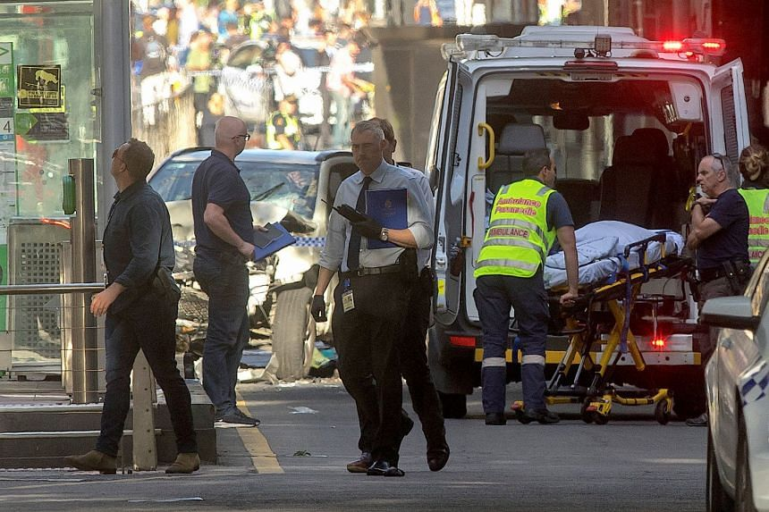 """Prosecutors said the suspect had driven his white SUV through the crowded Flinders Street intersection """"with the intention of killing or causing serious injury""""."""