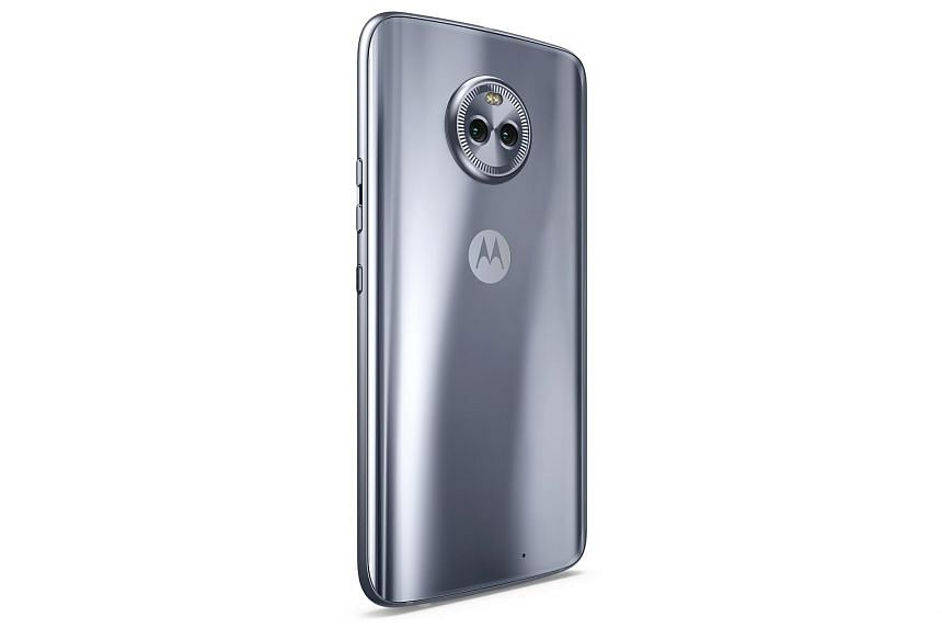 The Moto X4 has a fat bezel around its top and bottom, where the front-facing speaker and fingerprint sensor are sited.