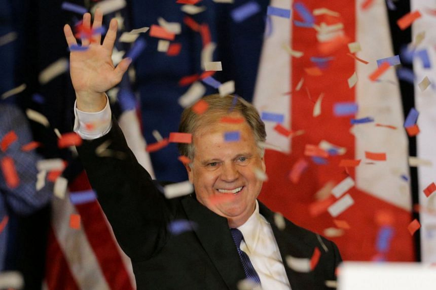 Doug Jones acknowledging supporters at the election night party in Birmingham, Alabama, Dec 12, 2017.