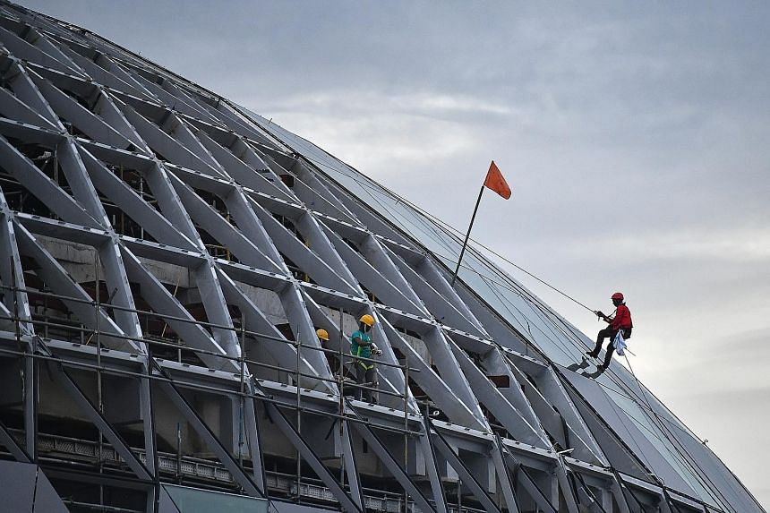 Work on Jewel Changi Airport is moving ahead at full-speed, with construction workers seen scaling its external facade on Tuesday. The complex is scheduled to open in early 2019, and will have five storeys above ground and five basement levels, with