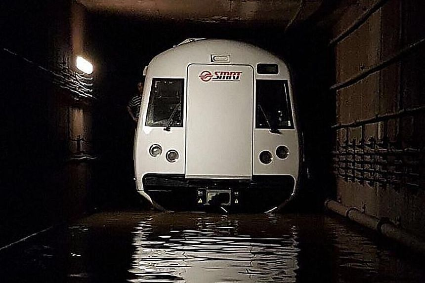 A train stalled in a flooded tunnel between the Braddell and Bishan MRT stations on Oct 7. It was later found that staff responsible for the maintenance of the flood prevention system had falsified records on three occasions, signing off on work that