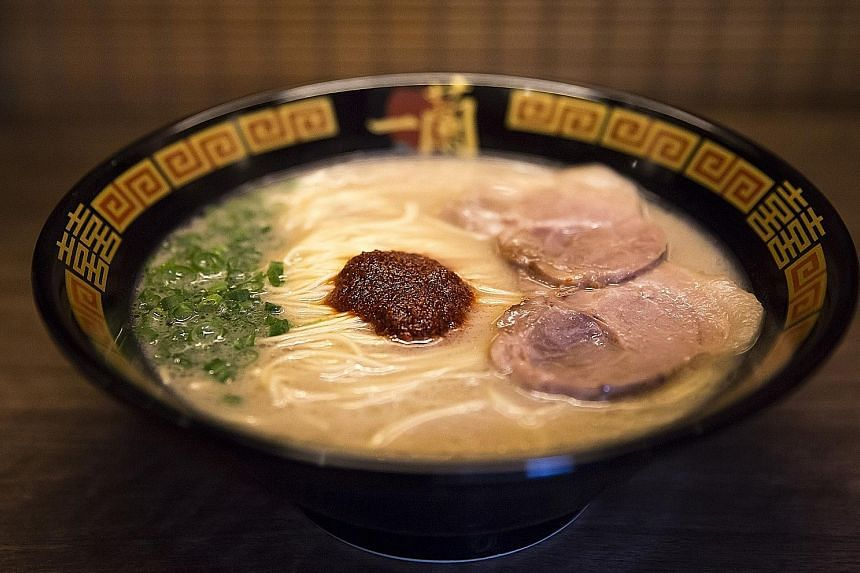 Ramen being prepared at a restaurant in Fukuoka. The city is expanding production of ra-mugi wheat, designed to be perfect with tonkotsu ramen (left).