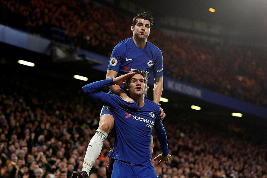 Chelsea wing-back Marcos Alonso saluting the Stamford Bridge crowd after scoring the second goal in the 2-0 win over Brighton on Tuesday as striker Alvaro Morata, scorer of the first goal, joins in the celebration.