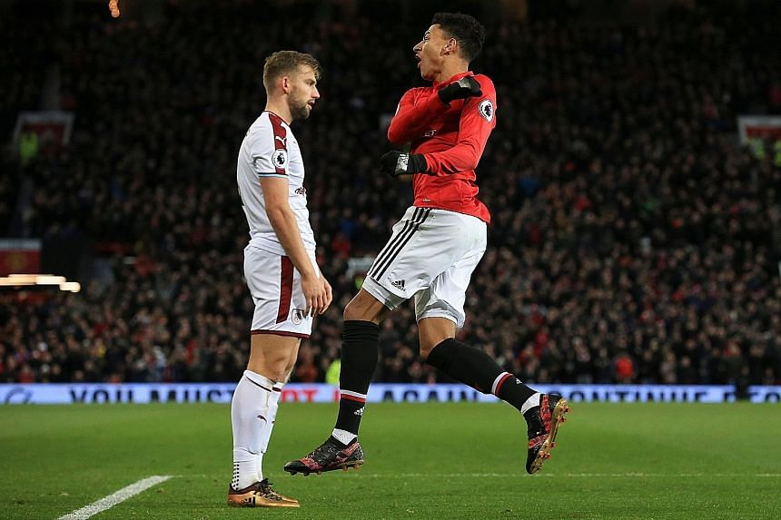 Manchester United midfielder Jesse Lingard (with Burnley's Charlie Taylor) celebrating pulling a goal back for the Red Devils on Tuesday after the visitors took a two-goal lead. Lingard then scored an injury-time equaliser which denied the Clarets th