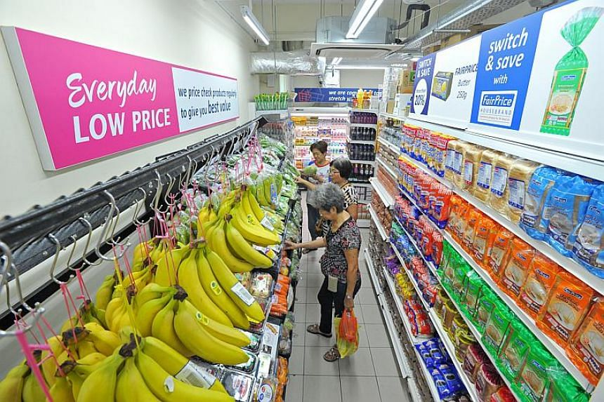 File photo of customers shopping at NTUC FairPrice.