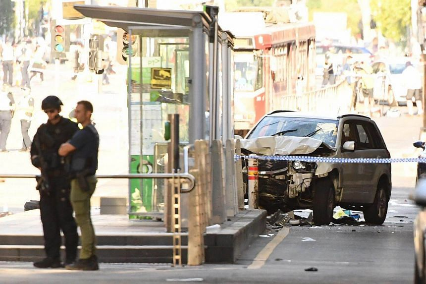 A damaged vehicle at the scene of an incident on Flinders Street, in Melbourne, on Dec 21, 2017.