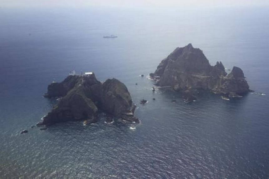 The disputed islets, called Dokdo by Seoul and Takeshima by Tokyo, lie roughly halfway between South Korea and Japan.