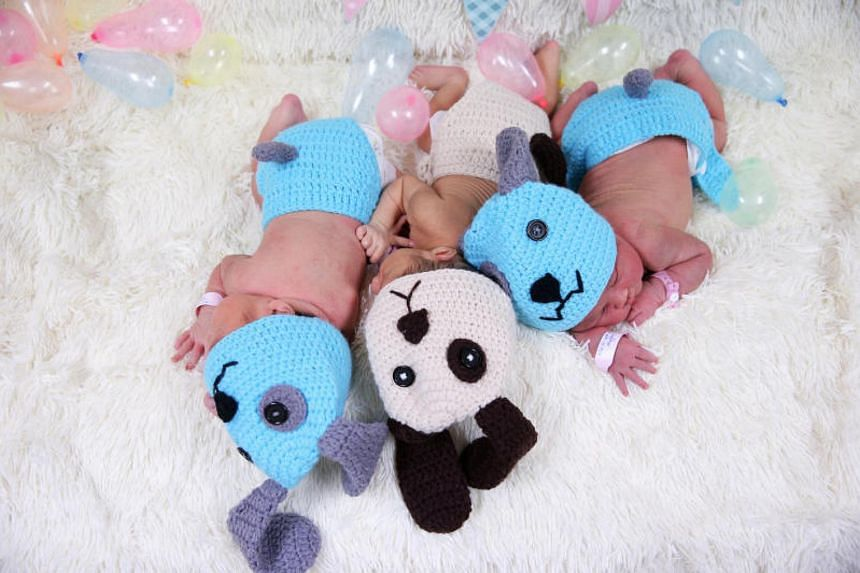 Staff at the Paolo Memorial Hospital Chokchai 4 dressed the babies in blue and brown crochet hats with dog ears and matching outfits for a photoshoot.