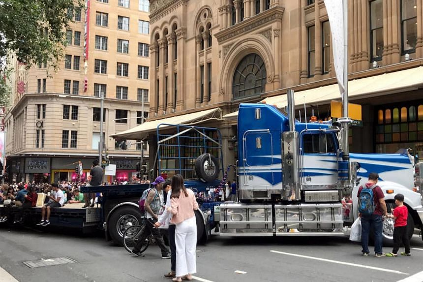 Semi-trailers and cranes are parked across Sydney's busiest streets this week as part of security measures against mass-casualty car attacks during the chaotic annual shopping frenzy on Dec 26, or Boxing Day.