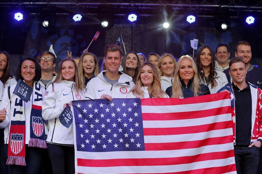 Olympians take part in an event at Times Square in New York City to celebrate 100 days from the start of the PyeongChang 2018 Olympic Games in South Korea.