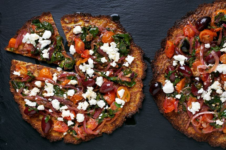 Cauliflower pizzas with chard and olives.