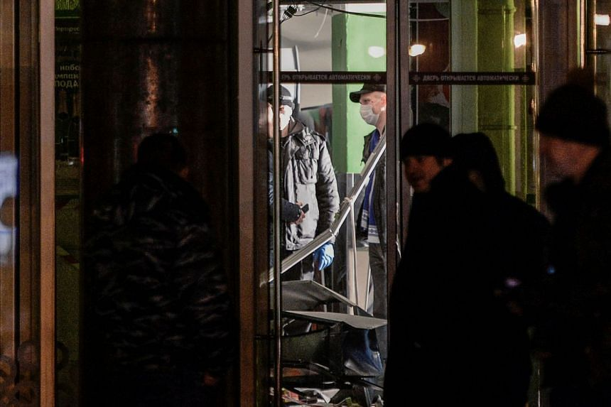 Investigators work at the site of a blast in a supermarket in Saint Petersburg on Dec 27, 2017.
