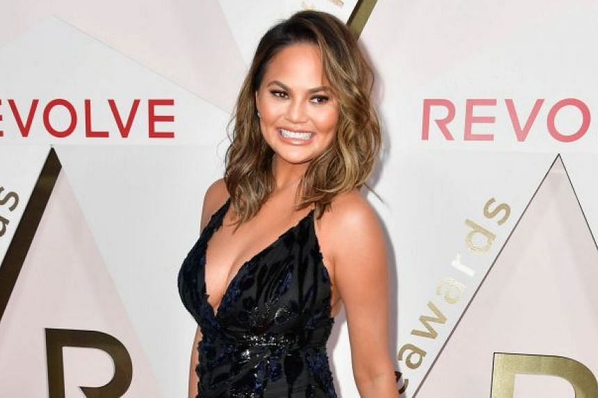 Model Chrissy Teigen, seen here at the Revolve Awards in Hollywood last month, was on an All Nippon Airways flight from Los Angeles to Tokyo on Tuesday that turned around midway.