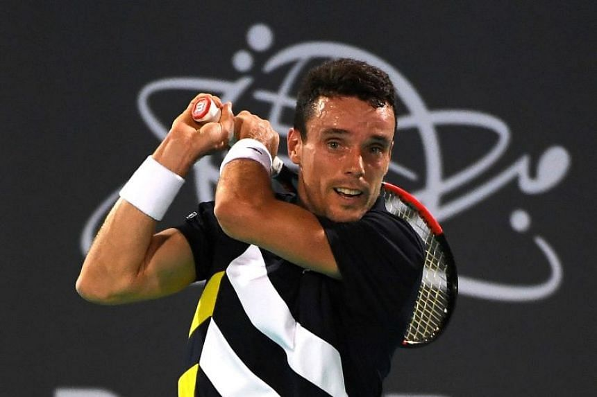 Bautista Agut in action against Andrey Rublev of Russia.