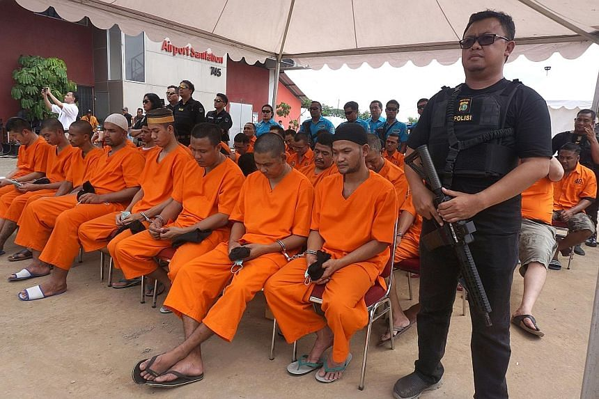 Convicted drug dealers at a National Narcotics Agency ceremony to destroy seized drugs in Jakarta yesterday. Of the 79 suspects killed, 10 were foreigners, said the agency.