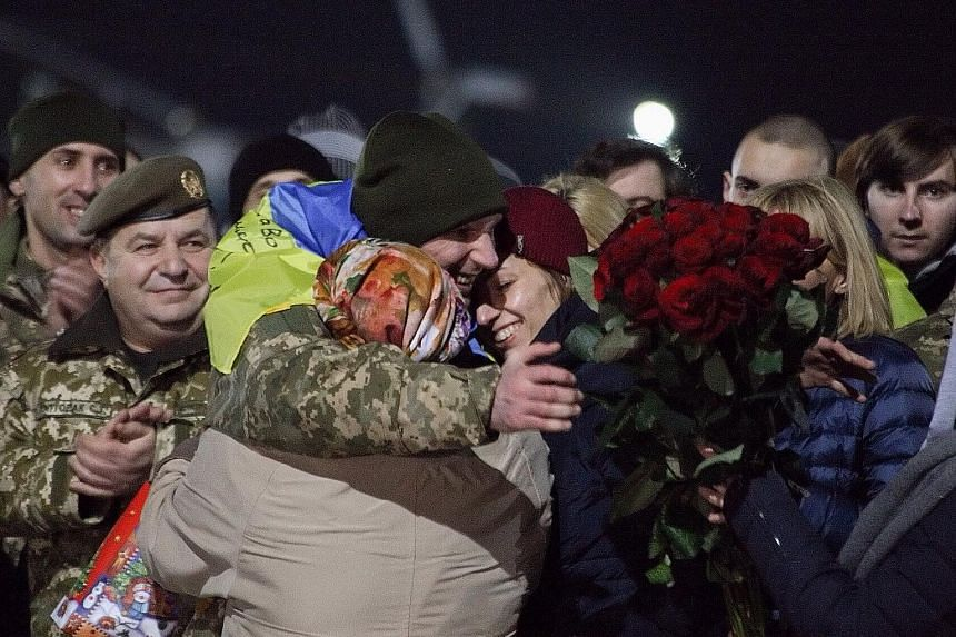 Relatives and friends welcoming a released Ukrainian hostage after the prisoner exchange at Kharkiv airport near Horlivka city in Ukraine on Wednesday.