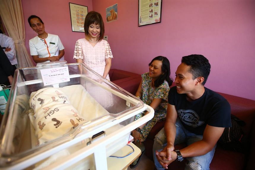 Dr Amy Khor with parents Nabilla and Fadli Bohari, with their newborn baby girl.