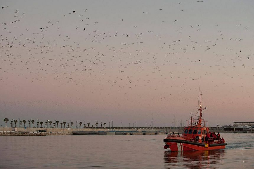 File photo of a coast guard boat carrying migrants arriving at a harbour in Malaga, Spain.