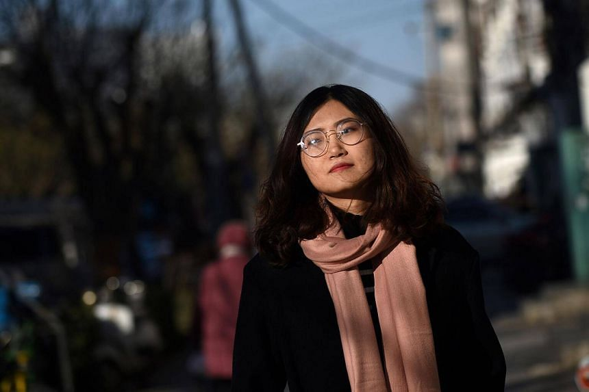 Wang Zhaoyue, a 24-year-old recent master's graduate, thinks she could achieve more if it were not for her Buddhist Youth philosophies.