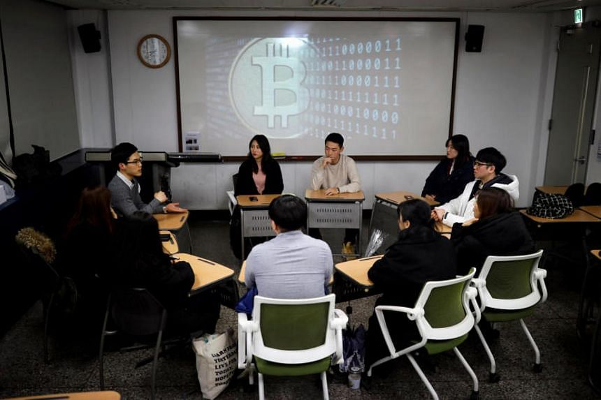 Members of a club studying cryptocurrencies at a meeting at a university in Seoul on Dec 20, 2017.