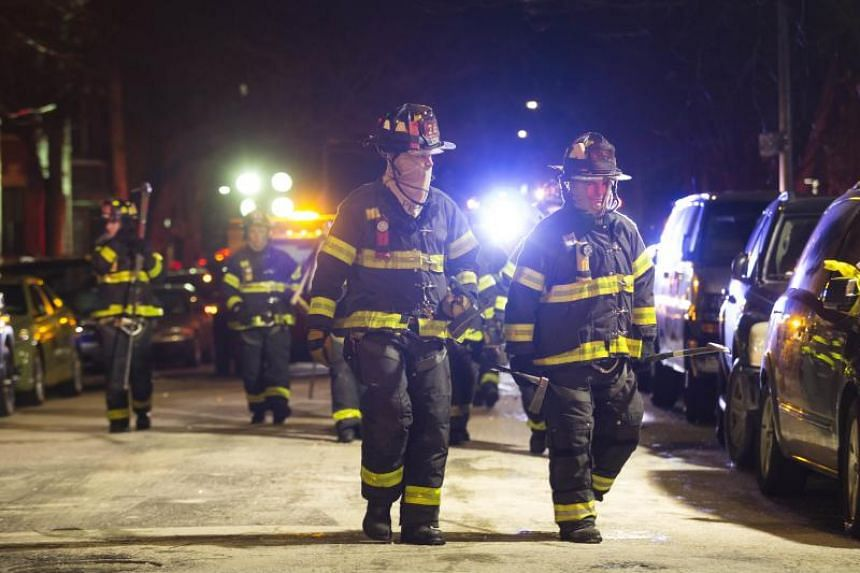 Firefighters leave after putting out a major house fire on Prospect avenue on Dec 28, 2017 in the Bronx borough of New York City.