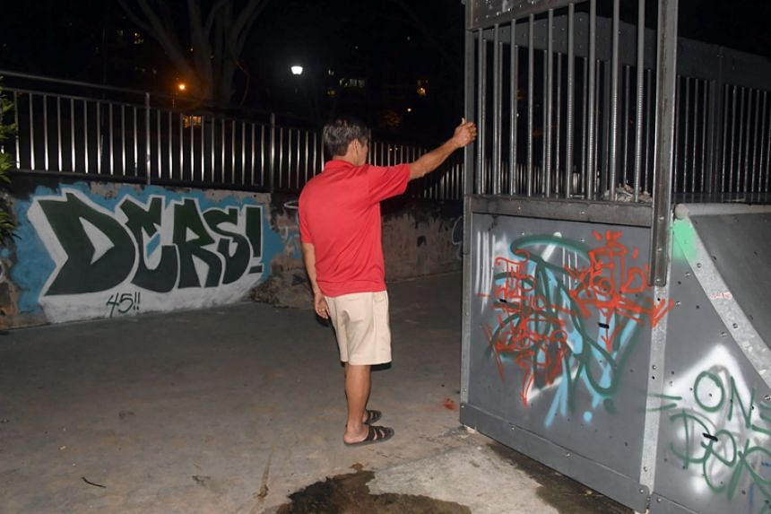 Mr Bai showing graffiti that was allegedly sprayed by two young men at a skatepark in Bedok on Dec 27, 2017.