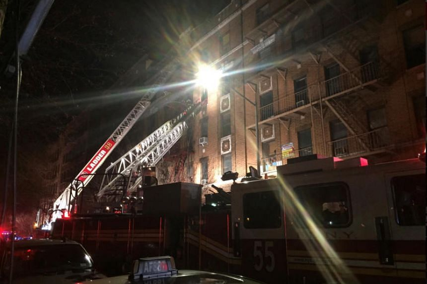 New York Fire Department ladder trucks are deployed at a building fire in the Bronx borough of New York City on Dec 28, 2017.