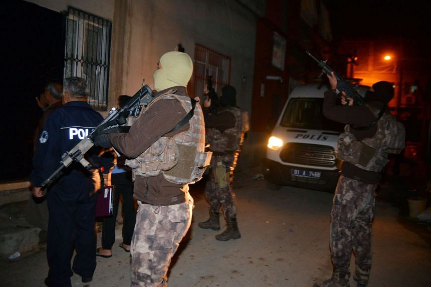 Members of the Turkish special police force take part in a house raid to arrest suspected members of the Islamic State group in Adana, on Nov 10, 2017.