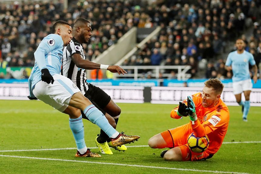 Newcastle goalkeeper Robert Elliot saving from Manchester City's Gabriel Jesus at St James' Park on Wednesday. The Magpies were especially negative in the opening half hour before Raheem Sterling scored the only goal of the game.