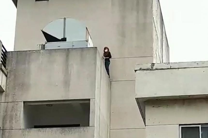 Ms Chew, 37, tried to jump from a multistorey carpark in Taiwan's Taoyuan city on Dec 28, 2017.