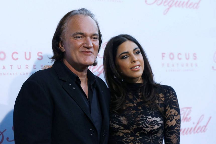 Director Quentin Tarantino and Daniela Pick pose at a premiere for The Beguiled in Los Angeles, California, in June 2017.