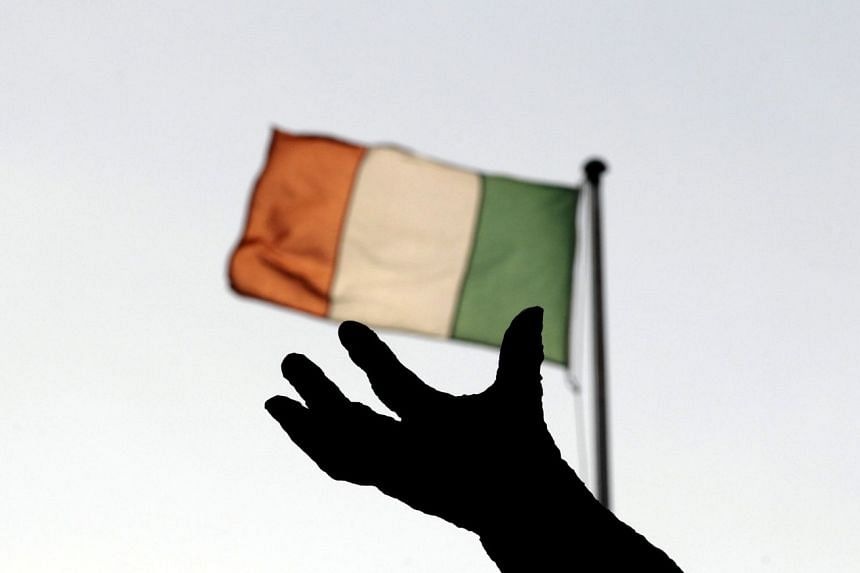 Ireland's national flag flies above a statue on O'Connell Street in Dublin.