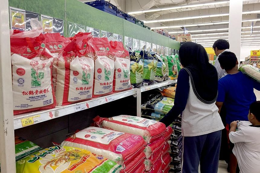 Packaged rice in a Kuala Lumpur supermarket. Most rice brands are linked to national rice agency Bernas.