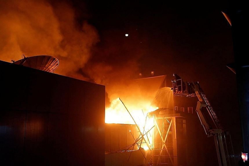 Firefighters trying to extinguish the blaze at 1 Above, a popular bar-restaurant on the top floor of a building in the Kamala Mills district in Mumbai early yesterday morning. It was reported that many victims could not find emergency exits. Firefigh