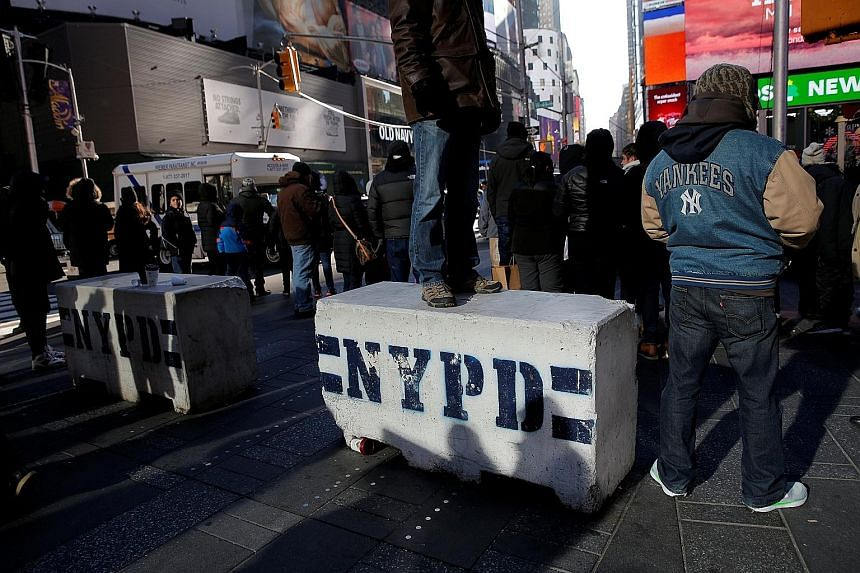 Bollards have been placed on sidewalks in Times Square as part of security moves against attacks by vehicles.