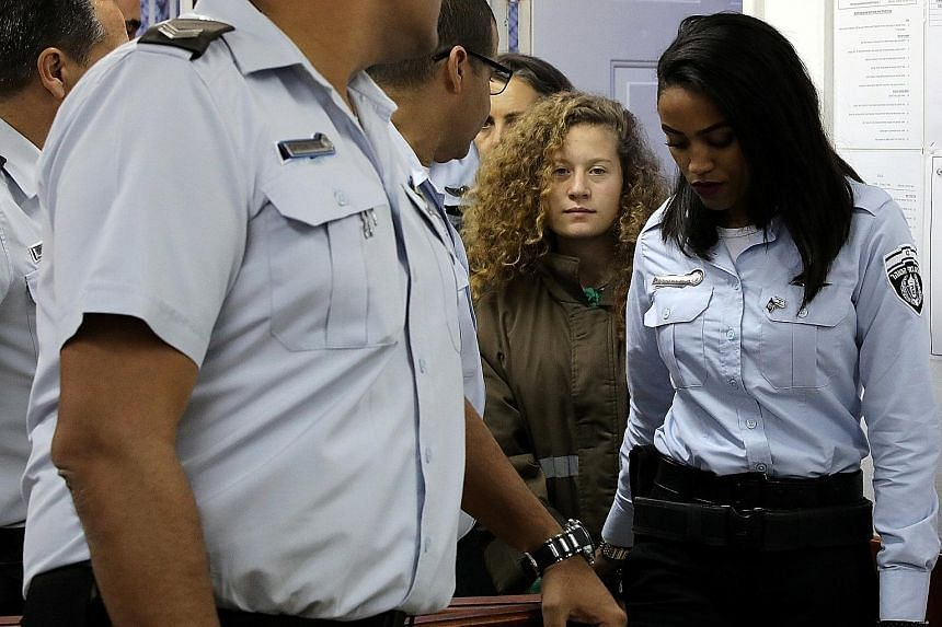 Ahed Tamimi being escorted into a military courtroom in Ramallah on Thursday. She has been held up by Palestinians and other supporters as a brave opponent of Israel's occupation of the West Bank.
