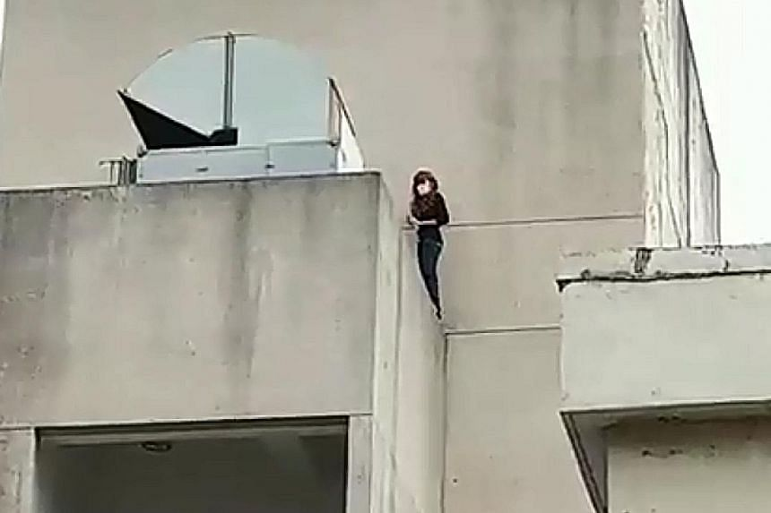 The Singaporean woman tried to jump off a building in Taoyuan, Taiwan, on Thursday.