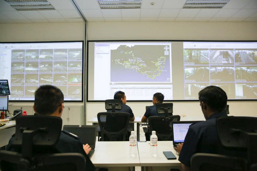 Police officers working at the Sentosa Development Corporation's Joint Command Centre, which they share with Sentosa Rangers.