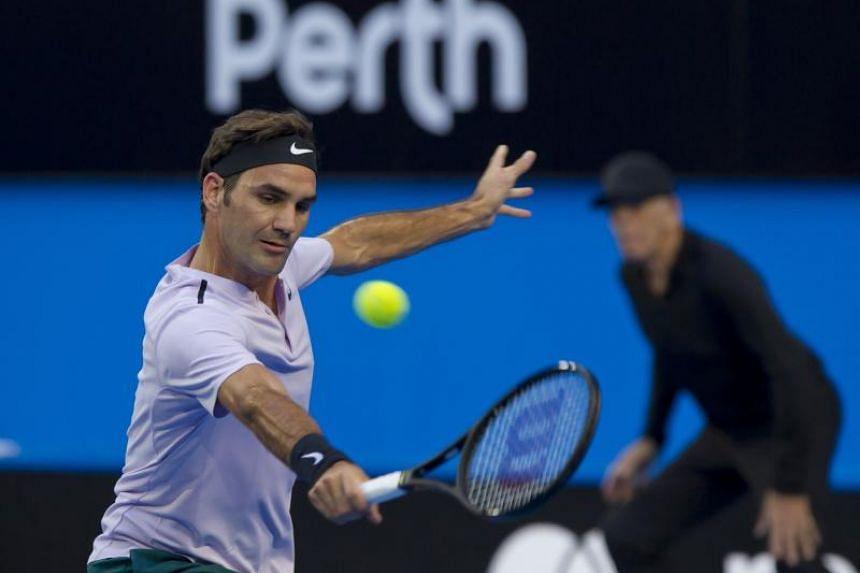 Switzerland's Roger Federer hitting a return against Yuichi Sugita of Japan.