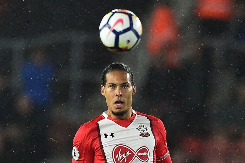Van Dijk (above) is expected to join Liverpool from Southampton as the world's most expensive defender.