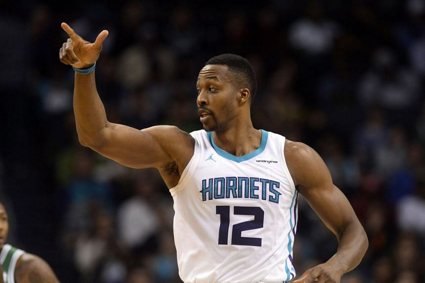 Dwight Howard led six Hornets players in double figures to snatch victory from the Golden State Warriors.