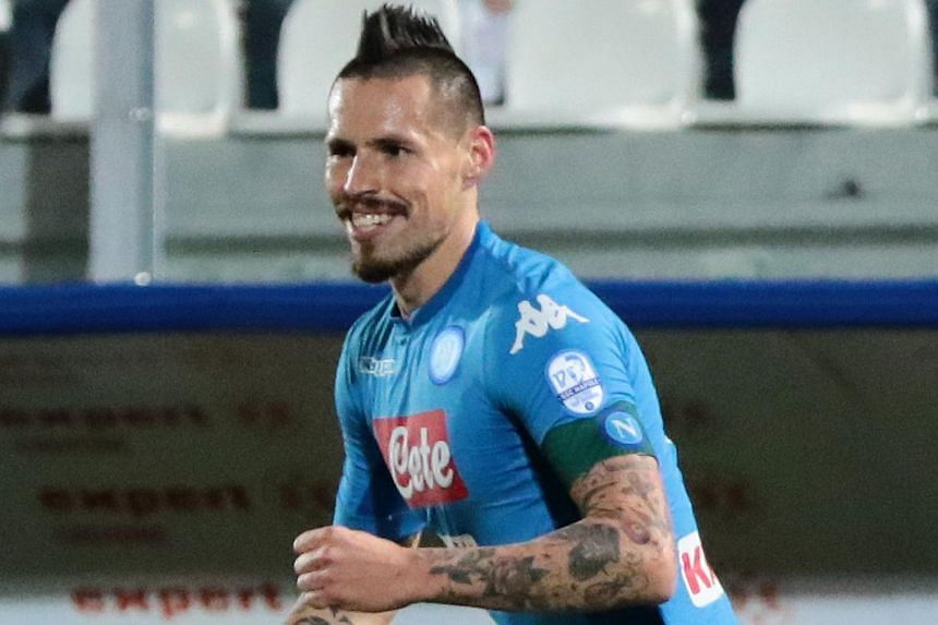 Marek Hamsik celebrates after scoring a goal during the Italian Serie A football match between FC Crotone and SSC Napoli on Dec 29, 2017.