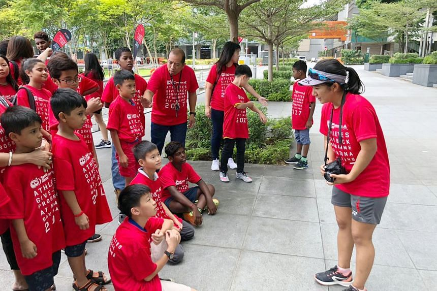 SEA Games 470 gold medallists Yukie Yokoyama (right) and Cheryl Teo led a group of six national sailors who hosted 40 needy children from Chen Su Lan Methodist Children's Home and Touch Young Arrows at Marina Bay yesterday, under the annual Athletes