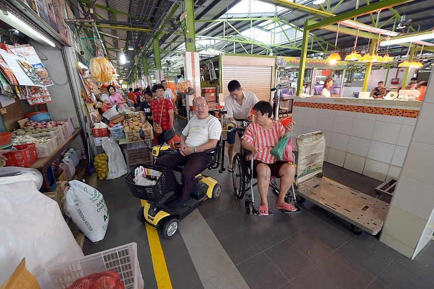 Mr Francis Tan, 80, who uses a personal mobility device to get about, welcomes the wider walkways and accessibility ramps at the newly renovated Bukit Merah View Food Centre and Market. Other new features include free Wi-Fi, slip-resistant flooring,
